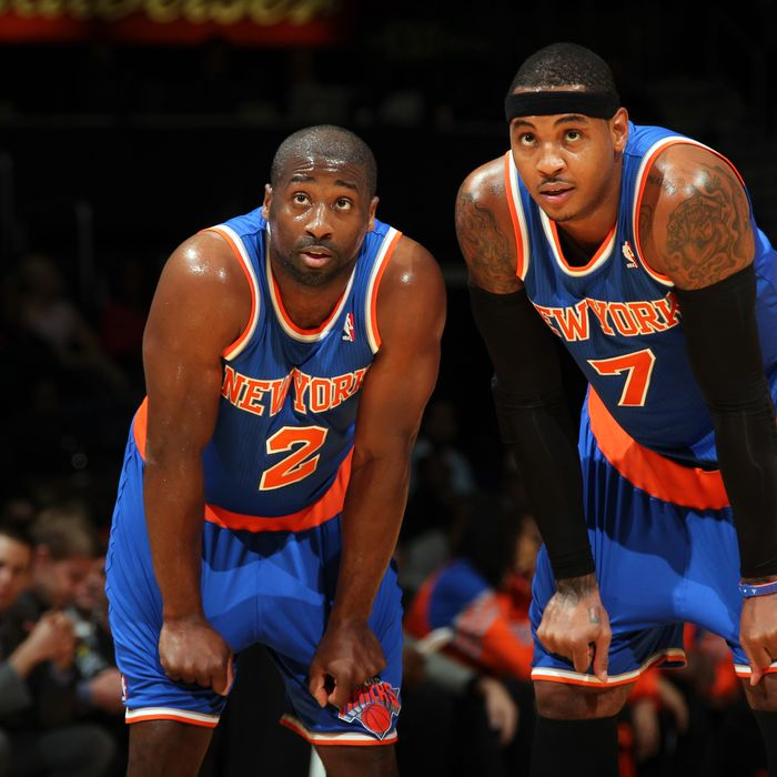 Raymond Felton #2 and Carmelo Anthony #15 of the New York Knicks talk on the court against the Washington Wizards during the game at the Verizon Center on October 11, 2012 in Washington, DC.