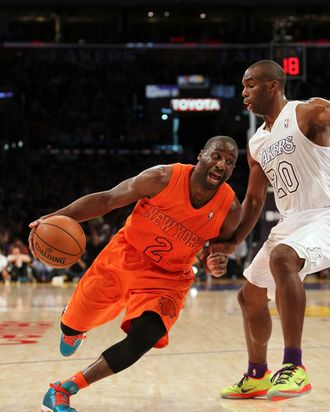 Raymond Felton #2 of the New York Knicks dribbles to the basket against Jodie Meeks #20 of the Los Angeles Lakers in the second half during the NBA game at Staples Center on December 25, 2012 in Los Angeles, California. The Lakers defeated the Knicks 100-94.