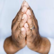 Edmonds, Washington State, USA --- African American man's hands in prayer position.