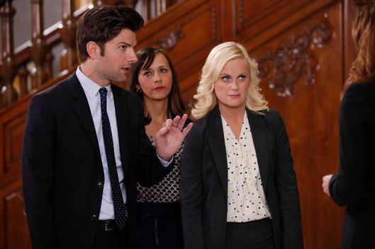 "PARKS AND RECREATION -- ""Bus Tour"" Episode 421 -- Pictured: (l-r) Adam Scott as Ben Wyatt, Rashida Jones as Ann Perkins, Amy Poehler as Leslie Knope."