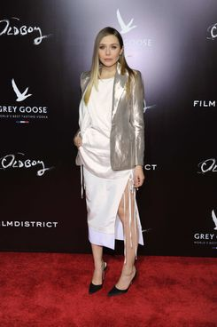 "Actress Elizabeth Olsen attends the screening of ""Oldboy"" hosted by FilmDistrict and Complex Media with the Cinema Society and Grey Goose at AMC Lincoln Square Theater on November 11, 2013 in New York City."