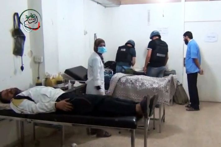 An image grab taken from a video uploaded on YouTube on August 26, 2013 allegedly shows a UN inspectors (C) visiting a hospital in the Damascus suburb of Moadamiyet al-Sham. UN inspectors reached a site near Syria's capital of a suspected chemical weapons attack to launch an investigation, meeting doctors and casualties.