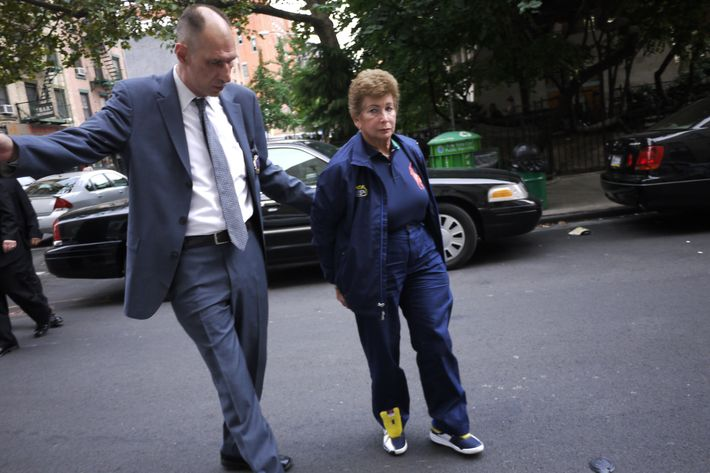 U.S. Open tennis umpire Lois Goodman, 70, was arrested at her New York hotel and charged with murdering her husband in Los Angeles.