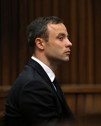 South African Paralympic track star Oscar Pistorius attends his trial in Court in Pretoria on April 7, 2014. As the defence opens its case, the 27-year-old Paralympian will give the court his first account of why he shot dead his model girlfriend Reeva Steenkamp in the early hours of Valentine's Day in 2013.