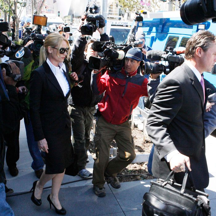 Nicollette Sheridan is quiet to the media as she leaves the courthouse after the case ends in a mistrial.