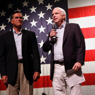 MESA, AZ - JUNE 4: U.S. Sen. John McCain (R-AZ) (R) is joined by former Massachusetts governor Mitt Romney as he speaks during a town hall meeting during a campaign stop at Mesa High School on June 4, 2010 in Mesa, Arizona. McCain, who is seeking a fifth term in the Senate, will challenge former congressman and radio personality J.D. Hayworth during the primary. (Photo by Joshua Lott/Getty Images)