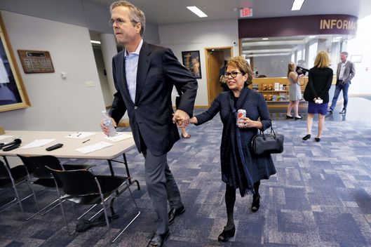 Bush and his wife, Columba, arrive at a town-hall meeting in May in  Dubuque, Iowa. Photo: Charlie Neibergall/AP Photo