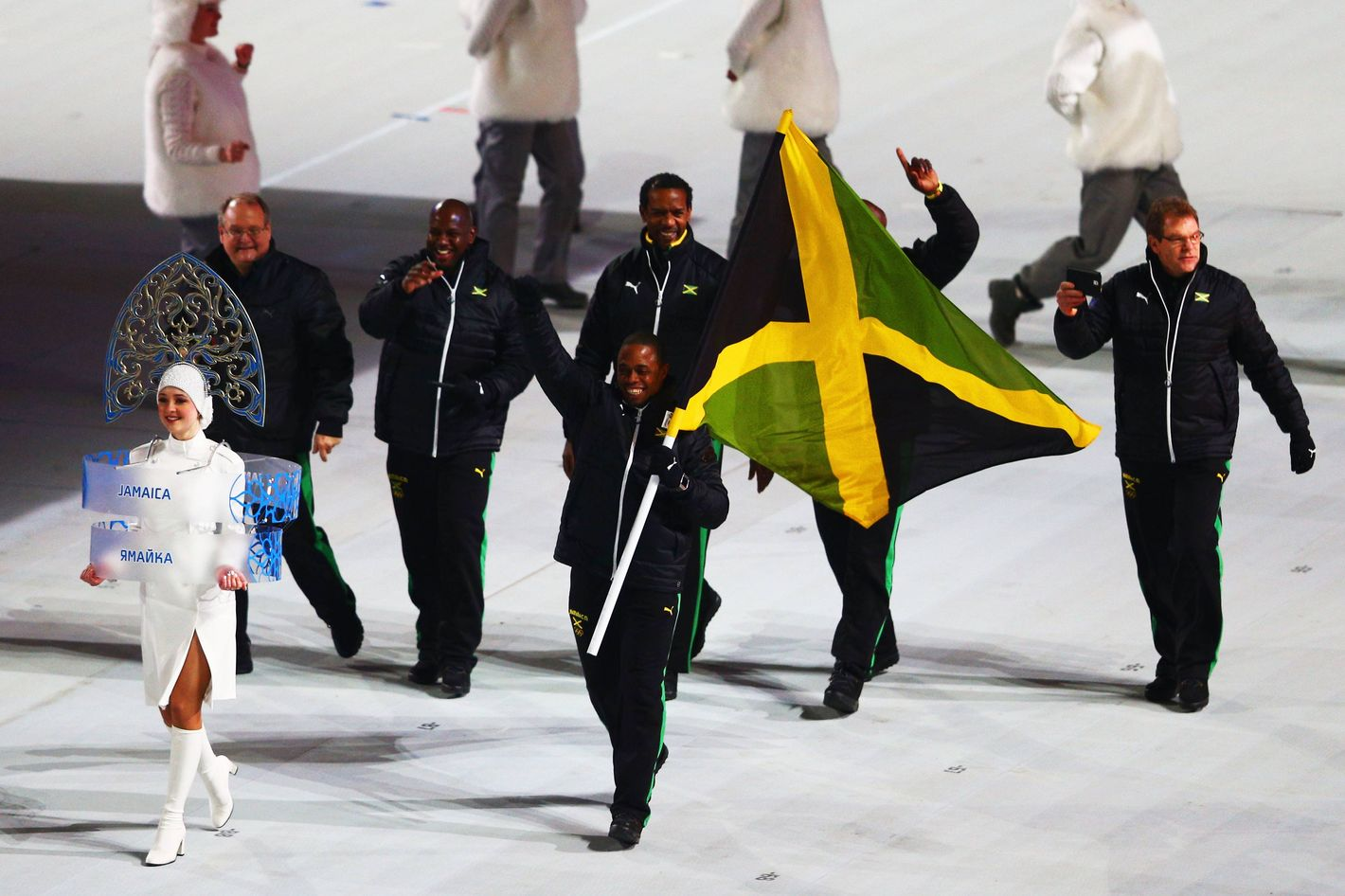 Bobsleigh racer Marvin Dixon of the Jamaica Olympic team carries his country's flag during the Opening Ceremony of the Sochi 2014 Winter Olympics at Fisht Olympic Stadium on February 7, 2014 in Sochi, Russia.