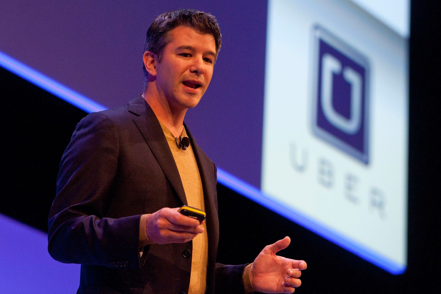 epa04430044 Travis Kalanick, Founder and CEO of Uber, delivers a speech at the Institute of Directors Convention at the Royal Albert Hall, Central London, Britain, 03 October 2014. The annual convention brings together business leaders and politicians to discuss the business strategy and the world economy.  EPA/WILL OLIVER