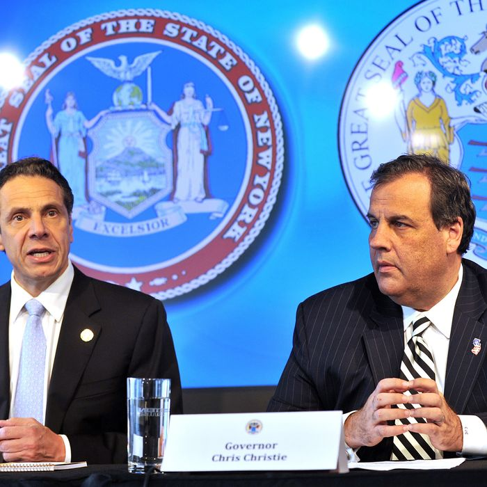 New York Governor Andrew M. Cuomo joins New Jersey Governor Chris Christie in announcing quarantine plans for people entering New York and New Jersey with symptoms of the Ebola virus during a press conference at 7 World Trade Center in New York City October 24, 2014.