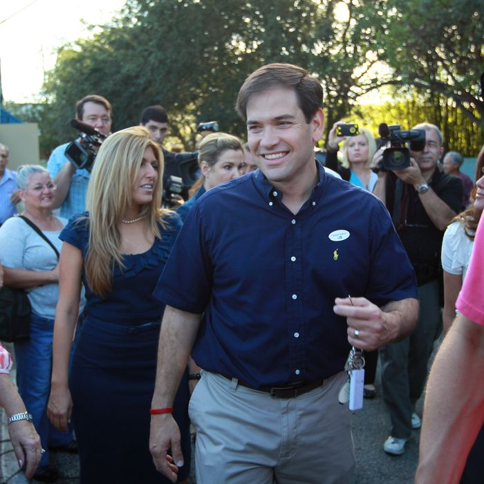Marco Rubio, Republican candidate for Florida's U.S. Senate seat, walks with his wife, Jeanette Rubio after casting his vote November 2, 2010 in West Miami, Florida.