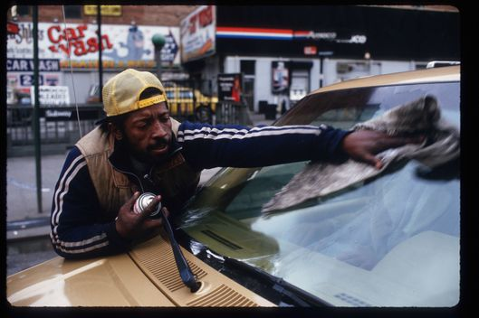047163 05: A squigee man cleans the windshield of a car January 3, 1988 in New York City. Beggars, panhandlers and window-washers are mostly individuals who are homeless, unemployed or unable to support themselves. (Photo by Stephen Ferry/Liaison)
