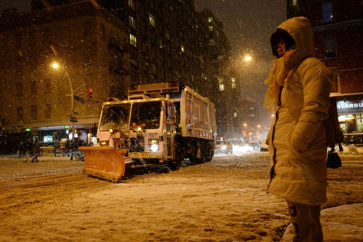 A snowplow drives down Lexington Avenue at East 96th Street on the east side of Manhattan as snow falls during the rush hour January 21, 2014 in New York. In New York, a storm alert was issue for noon (1700 GMT) Tuesday to 6:00 am (1100 GMT) Wednesday with as much as a foot (30 centimeters) forecast for the metropolitan region. AFP PHOTO/Stan HONDA        (Photo credit should read STAN HONDA/AFP/Getty Images)