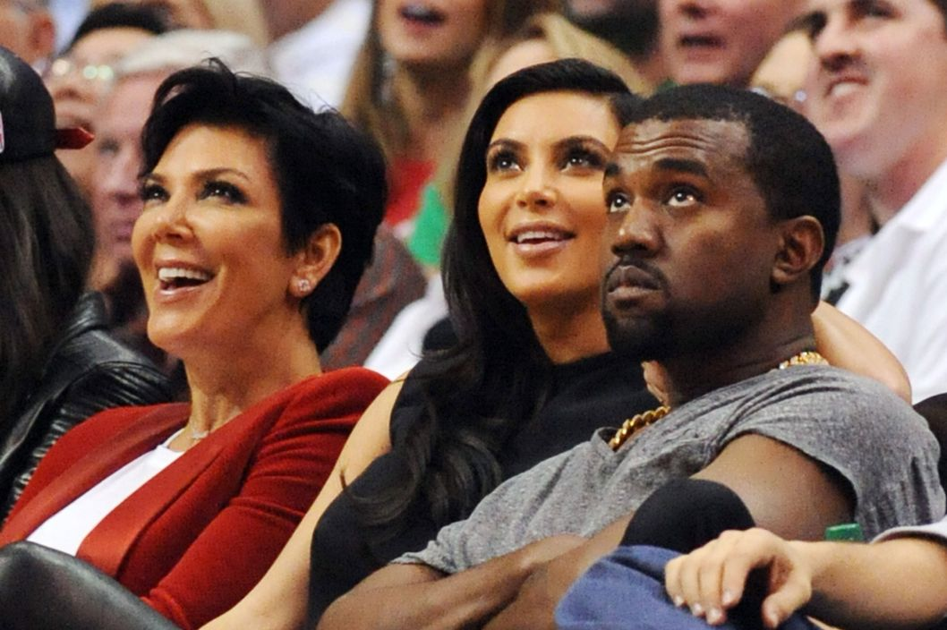 25 Dec 2012, Los Angeles, California, USA --- Kim Kardashian, Kanye West, Khloe Kardashian, Kris Jenner and Bruce Jenner watch the LA Clippers v Denver Nuggets NBA game at the Staples Center, Los Angeles, California. Pictured: Kris Jenner, Kim Kardashian and Kris Jenner  --- Image by ? Headlinephoto/ /Splash News/Corbis