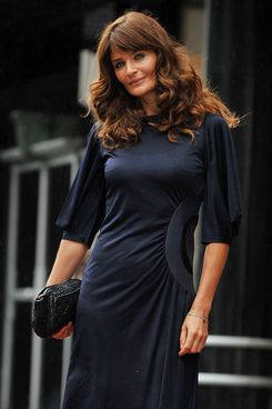 Model Helena Christensen poses for photographers during the launch of a new lingerie range in central London, on July 21, 2011. AFP PHOTO / BEN STANSALL (Photo credit should read BEN STANSALL/AFP/Getty Images)