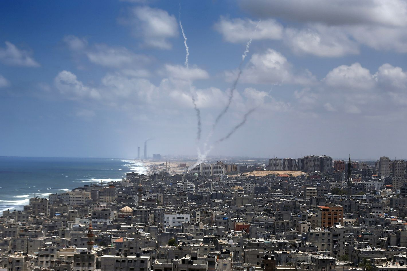 """Smoke from rockets fired from Gaza City are seen after being launched toward Israel, on July 15, 2014. US Secretary of State John Kerry  warned of the """"great risks"""" that the violence between Israel and the Gaza Strip could spiral out of control.   AFP PHOTO / THOMAS COEX        (Photo credit should read THOMAS COEX/AFP/Getty Images)"""