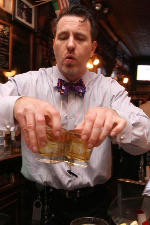 Doug Quinn serves drinks as he works at the bar at P.J. Clarke's Thursday, March 8, 2012 in New York.