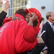 CHICAGO, IL - SEPTEMBER 18:  Chicago Teachers Union (CTU) delegates embrace after voting to end their strike on September 18, 2012 in Chicago, Illinois. More than 26,000 Chicago Public school teachers and support staff walked off the job on September 10 after the union failed to reach an agreement with the city on compensation, benefits and job security. With about 350,000 students, the Chicago school district is the third largest in the United States. Students will return to school tomorrow.  (Photo by Scott Olson/Getty Images)