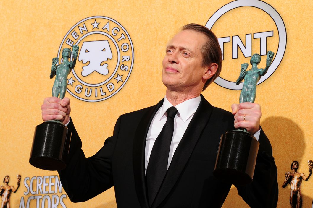 Actor Steve Buscemi holds the award for best actor in a drama series for his role in 'Boardwalk Empire' in the press room at the 18th Annual Screen Actors Guild Awards at the Shrine Auditorium in Los Angeles, California on January 29, 2012. AFP PHOTO / FREDERIC J. BROWN (Photo credit should read FREDERIC J. BROWN/AFP/Getty Images)