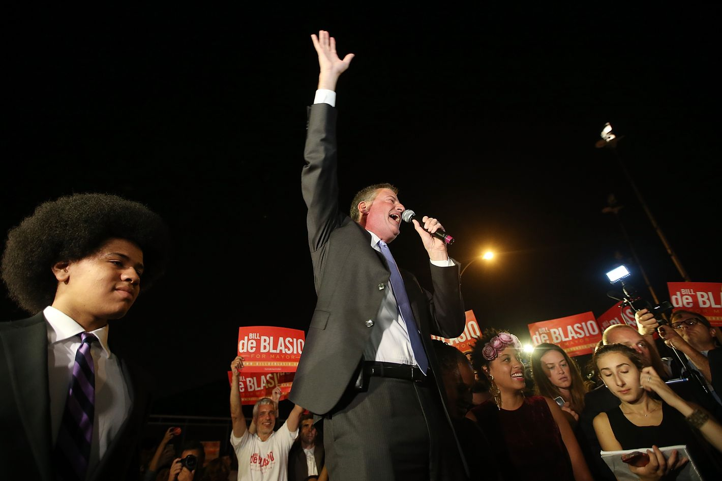 NEW YORK, NY - SEPTEMBER 10:  Democratic candidate for mayor and Public Advocate Bill de Blasio (C) waves to the crowd as his son Dante (L) looks on while arriving at his primary night party on September 10, 2013 in the Brooklyn borough of New York City.  De Blasio is leading the Democratic race, according to exit polls. (Photo by Mario Tama/Getty Images)