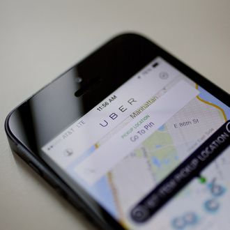 Th Uber Technologies Inc. car service application (app) is displayed for a photograph on an Apple Inc. iPhone in New York, U.S., on Wednesday, Aug. 6, 2014. For San Francisco-based Uber Technologies Inc. which recently raised $1.2 billion of investors' financing at $17 billion valuation, New York is its biggest by revenue among the 150 cities in which it operates across 42 countries. The Hamptons are a pop-up market for high-end season weekends where the average trip is three time that of an average trip in New York City. Photographer: Victor J. Blue/Bloomberg via Getty Images