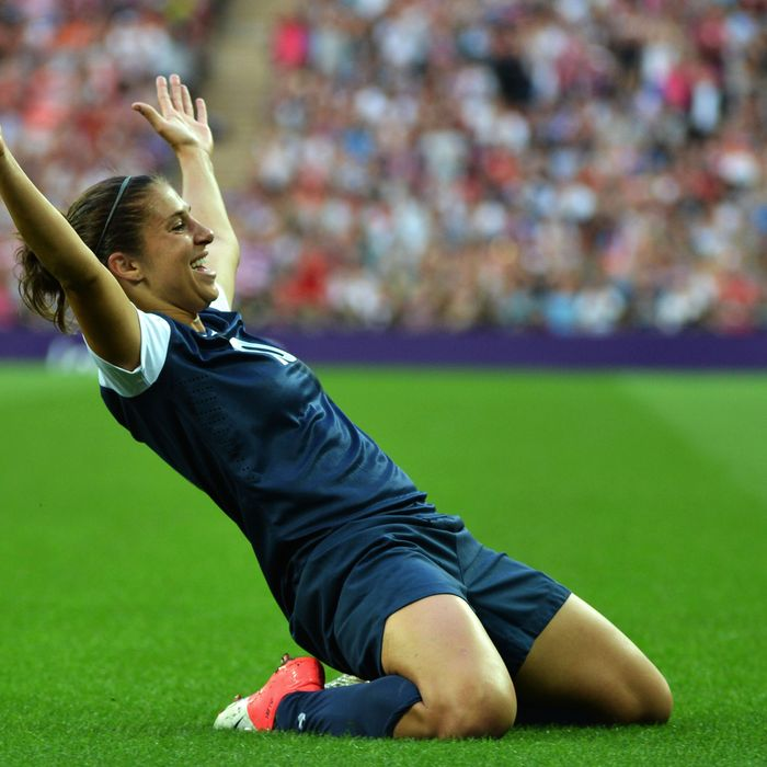 US midfielder Carli Lloyd celebrates scoring a goal during the final of the women's football competition of the London 2012 Olympic Games on August 9, 2012 at Wembley stadium in London.