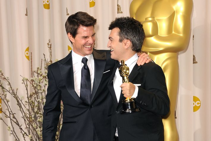 Producer for 'The Artist,' Thomas Langmann (R), poses with actor Tom Cruise (L) in the press room at the 84th Annual Academy Awards held at the Hollywood & Highland Center on February 26, 2012 in Hollywood, California.