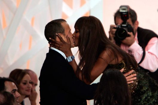 British model Naomi Campbell, right, kisses Russian billionaire boyfriend Vladislav Doronin, after he bought the dress she was wearing for 25,000 british pounds(some 45,449 US dollars, some 31,632 Euros) during an auction following the Fashion For Relief show, during London Fashion Week at the Natural History Museum in central London, Wednesday Sept. 17, 2008. Funds were raised by the show and a following auction for The White Ribbon Alliance charity to be used directly to promote and increase awareness of the need to make pregnancy and childbirth safe for women and newborns in developing and developed countries. (AP Photo/Lefteris Pitarakis)