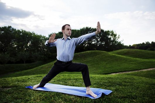 Businessman is doing yoga