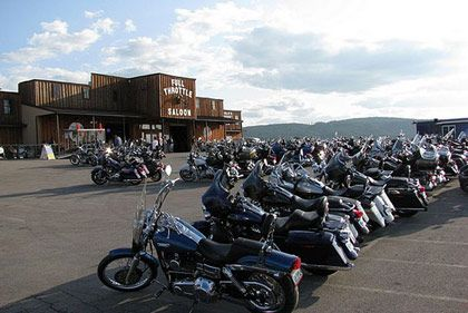 "<b>The Destination:</b> <a href=""http://www.fullthrottlesaloon.com/"">Full Throttle Saloon</a> in Sturgis  <b>How to Get There:</b> Fly into Rapid City Airport and take the I-90 West about 40 miles to Sturgis. Do it riding a hog.  <b>When to Go:</b> The bar is only open for six days this year during the 72nd Annual Sturgis Motorcycle Rally, running from August 6 to 12.     This 30-acre Black Hills encampment earned its patch as ""America's Biggest Biker Bar,"" with roughly 15,000 visitors a night and enough bad behavior to fill its own reality show. Live acts (everyone from Molly Hatchet to Ice-T) vie for attention with wrestling exhibitions, a ""wall of death,"" freak shows, and burn-out pits, all fueled by a shit ton of booze.  <i>Full Throttle Saloon, 12997 Sd Highway 34, Sturgis, SD; 605-423-4584</i>"