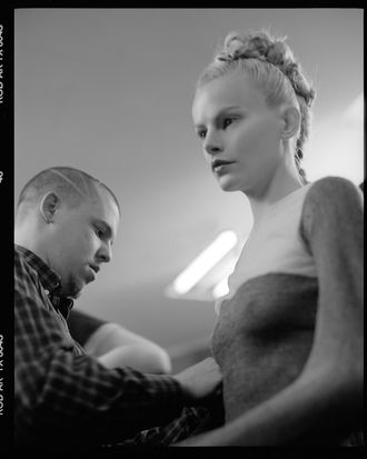 McQueen backstage with a model, 1996.