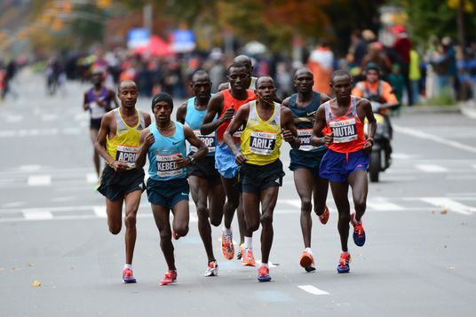 Runners race in the New York City Marathon on November 3, 2013. Geoffrey Mutai (R) of Kenya won the race in the men's division with a time of 02:08:24.