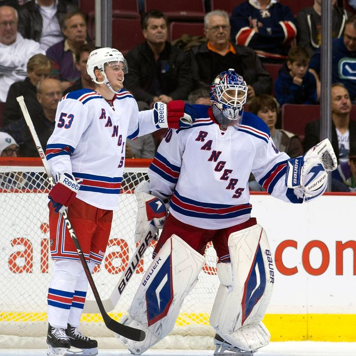 VANCOUVER, CANADA - OCTOBER 18: Goalie Henrik Lundqvist #30 of the New York Rangers is congratulated by teammate Tim Erixon #53 after shutting out the Vancouver Canucks during NHL action on October 18, 2011 at Rogers Arena in Vancouver, British Columbia, Canada. (Photo by Rich Lam/Getty Images)