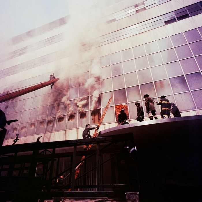 1958, Manhattan, New York City, New York State, USA --- Firemen combat a fire on the exterior facade of the Museum of Modern Art. The fire was started by welders during a renovation process. --- Image by ? Charles E. Rotkin/CORBIS