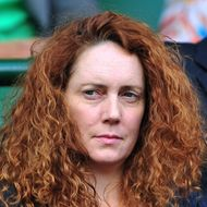 A picture taken on July 1, 2011 shows Chief Executive of News International, and former editor of Britain's News of the World newspaper, Rebekah Brooks, at the men's single semi final at the Wimbledon Tennis Championships in London.  British police on July 17, 2011 arrested Rebekah Brooks, the former head of media mogul Rupert Murdoch's British newspaper wing, over the phone hacking scandal, British media reported. Scotland Yard said in a statement that a 43-year-old woman had been arrested over allegations of phone hacking and corruption. They would not confirm it was Brooks, 43, and there was no immediate comment from News International. AFP PHOTO / LEON NEAL - RESTRICTED TO EDITORIAL USE (Photo credit should read LEON NEAL/AFP/Getty Images)