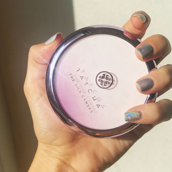 Rio Viera Newton holding her new Tatcha primer in her hand.