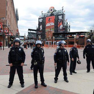 BALTIMORE, MD - APRIL 27: Police stand watch outside Oriole Park at Camden Yards before the game was postponed between the Baltimore Orioles and the Chicago White Sox on April 27, 2015 in Baltimore, Maryland. The move comes amid violent clashes between police and youths, according to news reports, the aftermath of the death of Freddie Gray on April 19 after suffering a fatal spinal injury while in police custody. (Photo by Greg Fiume/Getty Images)