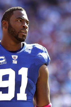 EAST RUTHERFORD, NJ - OCTOBER 17:  Justin Tuck #91  of the New York Giants against the Detroit Lions at New Meadowlands Stadium on October 17, 2010 in East Rutherford, New Jersey.  (Photo by Nick Laham/Getty Images) *** Local Caption *** Justin Tuck