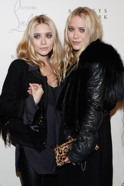 Ashley Olsen and Mary-Kate Olsen attend the Christian Louboutin Cocktail party at Barneys New York on November 1, 2011 in New York City.