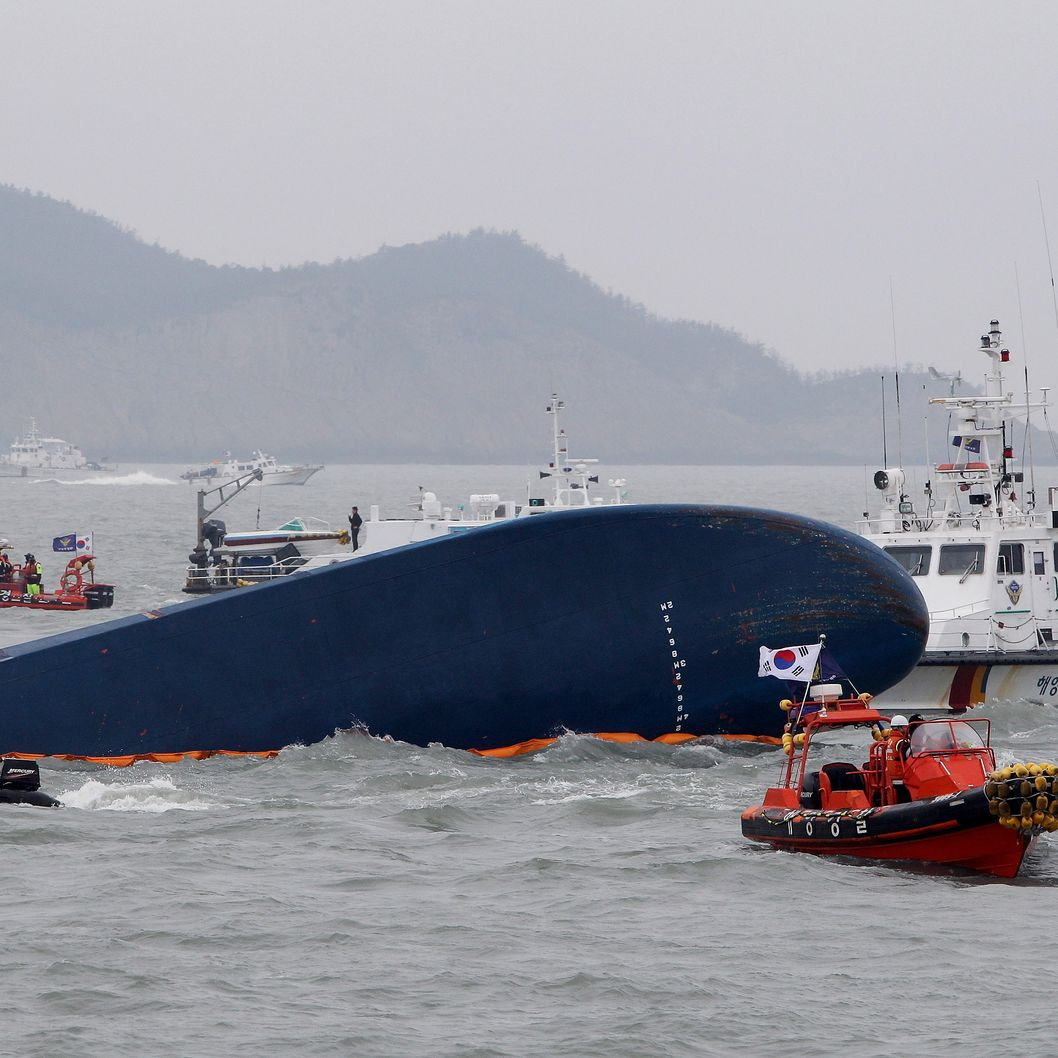 JINDO-GUN, SOUTH KOREA - APRIL 17:  South Korean Coast Guard and rescue teams search for missing passengers at the site of the sunken ferry off the coast of Jindo Island on April 17, 2014 in Jindo-gun, South Korea. At least six people are reported dead, with 290 still missing. The ferry identified as the Sewol was carrying about 470 passengers, including students and teachers, traveling to Jeju Island.  (Photo by Chung Sung-Jun/Getty Images)