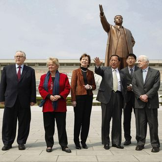 PYONGYANG, NORTH KOREA - APRIL 26: In this handout image providedby The Elders, Council of Elders members (L - 3rd L) former president of Finland Martti Ahtisaari, former Prime Minister of Norway Gro Brundtland, former Prime Minister of Ireland Mary Robinson and and Former U.S. President Jimmy Carter (R) stand with Vice Minister of Foreign Affairs of North Korea, Ri Yong Ho and an interpreter close to the statue of Kim IL-Sung on April 26, 2011 in Pyongyang, North Korea. The Elders visit was aimed to help ease tensions between North and South Korea and address humanitarian issues. (Photo by Richard Lewis/The Elders via Getty Images) *** Local Caption *** Martti Ahtisaari;Gro Brundtland;Mary Robinson;Ri Yong Ho;Jimmy Carter;