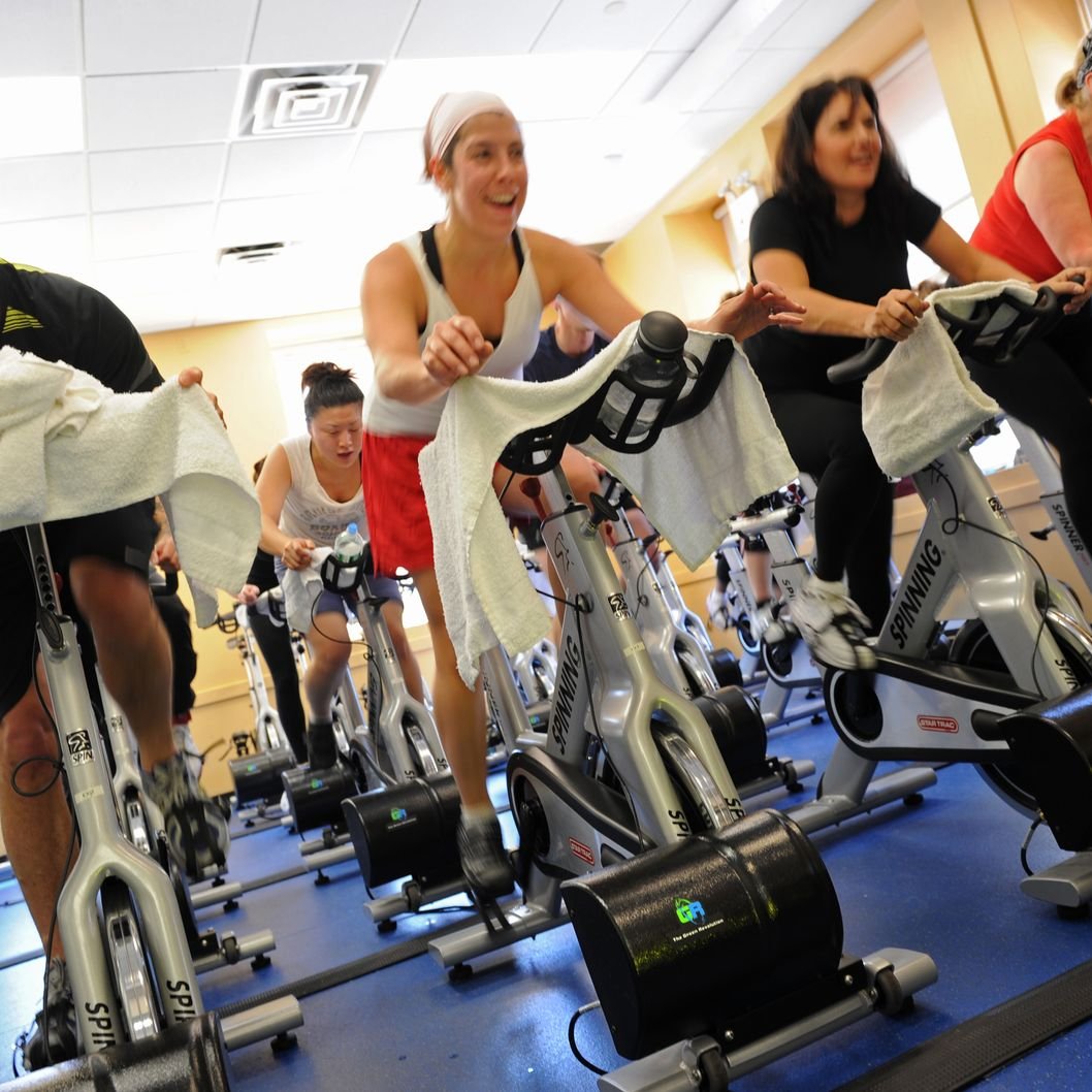 People in a spinning class at a New York Sports Clubs gym.