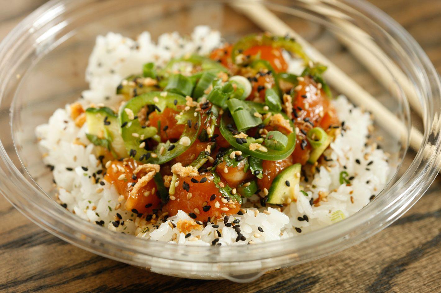 Heat Wave over white rice: salmon, cucumber, jalapeños, scallions, herb mix, spicy citrus, shoyu.