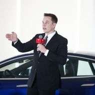 BEIJING, CHINA - OCTOBER 23: (CHINA OUT) Elon Musk, Chairman, CEO and Product Architect of Tesla Motors, addresses a press conference to declare that the Tesla Motors releases v7.0 System in China on a limited basis for its Model S, which will enable self-driving features such as Autosteer for a select group of beta testers on October 23, 2015 in Beijing, China. The v7.0 system includes Autosteer, a new Autopilot feature. While it's not absolutely self-driving and the driver still need to hold the steering wheel and be mindful of road conditions and surrounding traffic when using Autosteer. When set to the new Autosteer mode, graphics on the driver's display will show the path the Model S is following, post the current speed limit and indicate if a car is in front of the Tesla.  (Photo by ChinaFotoPress/Getty Images)