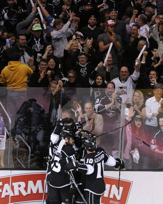 (L-R) Willie Mitchell #33, Jeff Carter #77, Slava Voynov #26, Dustin Penner #25 and Mike Richards #10 of the Los Angeles Kings celebrate Carter's goal in the third period against the New Jersey Devils in Game Three of the 2012 Stanley Cup Final