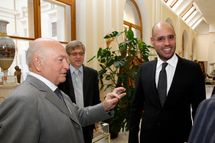 Saif al-Islam Kadhafi, the son of Libyan leader Moamer Kadhafi, listens to the Mayor of Moscow Yury Luzhkov during a visit to the City Hall on June 28, 2010. AFP PHOTO/MAHMUD TURKIA (Photo credit should read MAHMUD TURKIA/AFP/Getty Images)