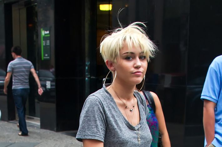 Miley and her haircut hit the town.