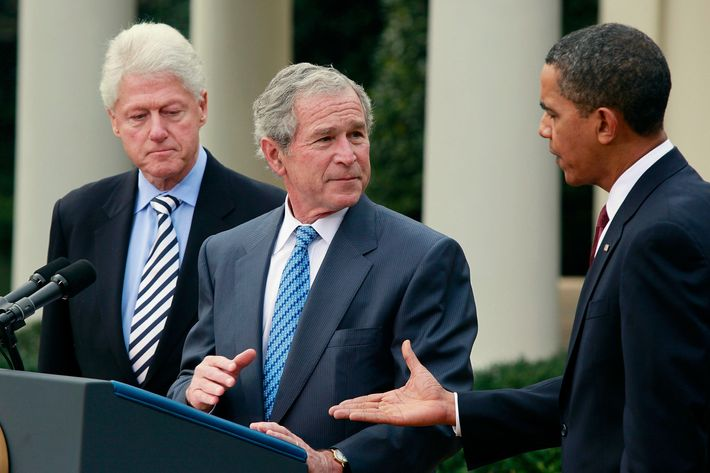 President Barack Obama extends his hand to former President George W. Bush (C) as former President Bill Clinton (L) looks on in the Rose Garden of the White House January 16, 2010 in Washington DC.