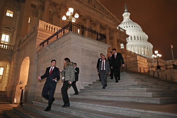 "WASHINGTON, DC - JANUARY 01:  Members of the House of Representatives, including Rep. Jason Chaffetz (R-UT) (L), leave after voting for legislation to avoid the ""fiscal cliff"" during a rare New Year's Day session  January 1, 2013 in Washington, DC. Voting 257-167, the House passed a bill that the Senate passed the night before, clearing the way for President Barack Obama to sign the legislation to avoid the ""fiscal cliff.""  (Photo by Chip Somodevilla/Getty Images)"