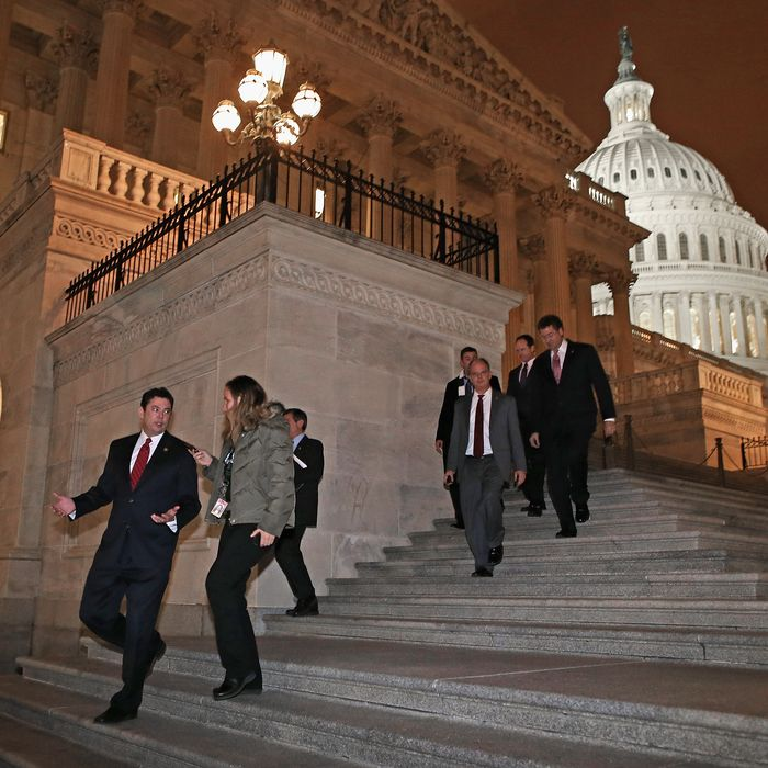 WASHINGTON, DC - JANUARY 01: Members of the House of Representatives, including Rep. Jason Chaffetz (R-UT) (L), leave after voting for legislation to avoid the